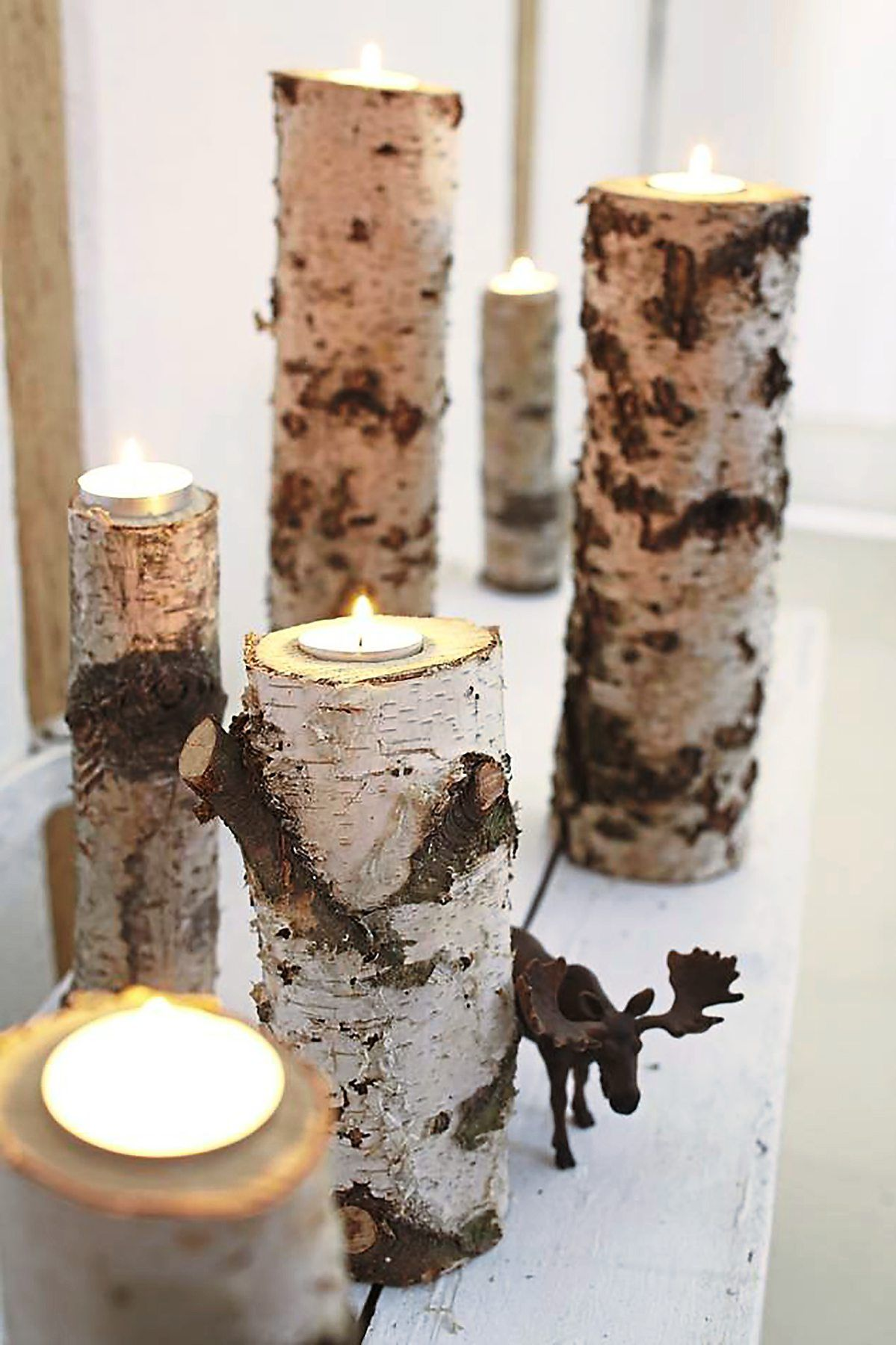 Birch trunks can easily be transformed into tea light holders. Photo: Bosch/DIY Acadamy/dpa
