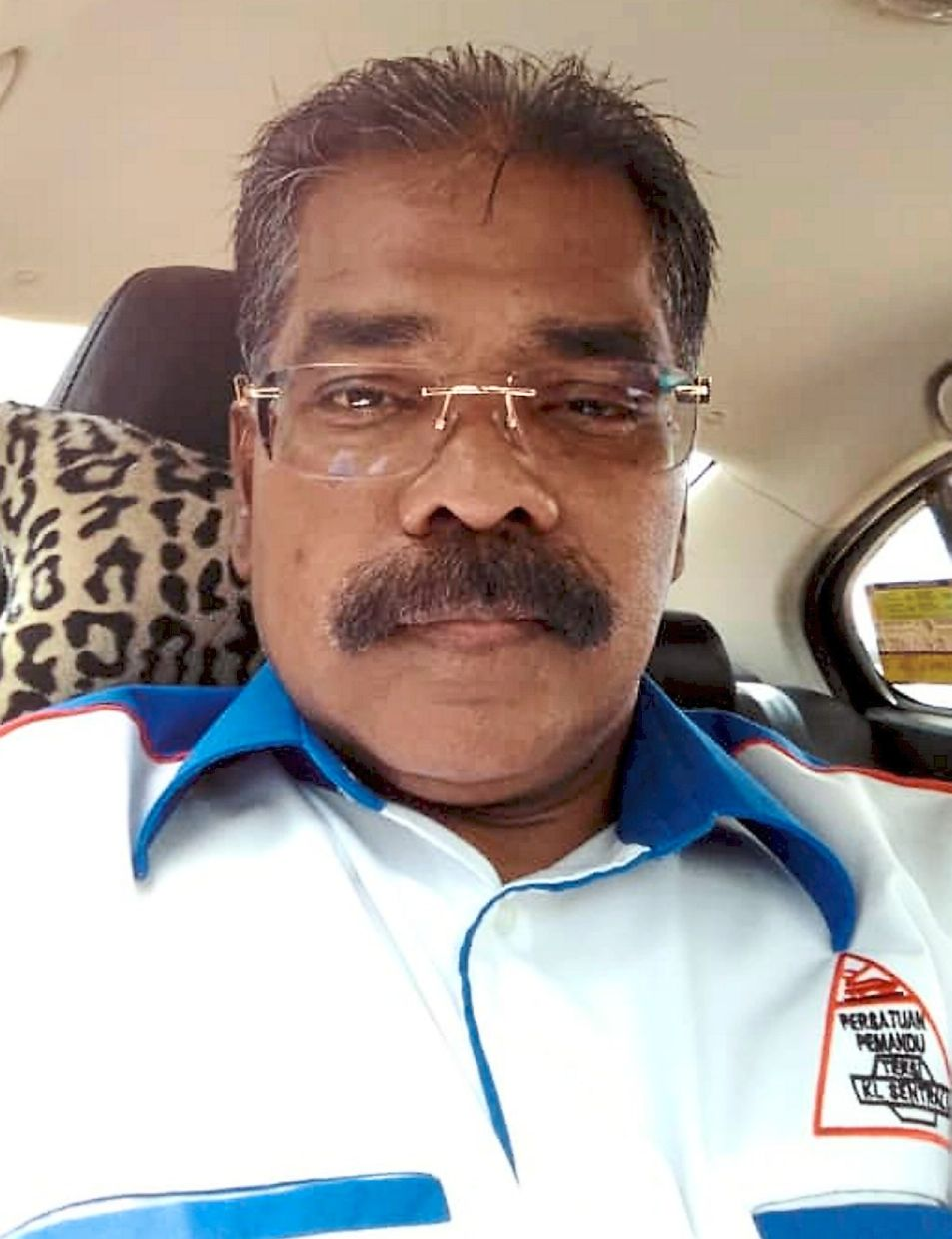 Pachymuthu soldiers on with his taxi service despite the fewer number of passengers during the MCO.