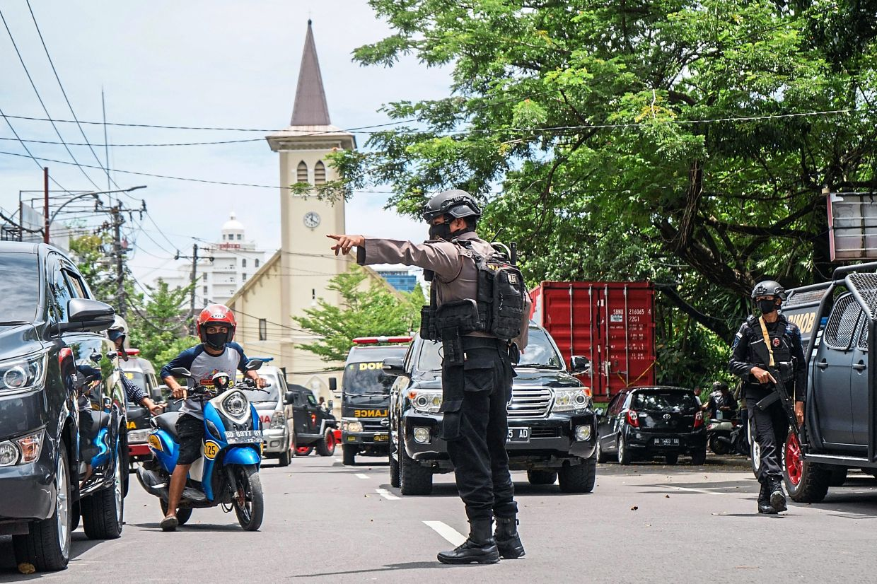 A policeman directing traffic after the explosion.