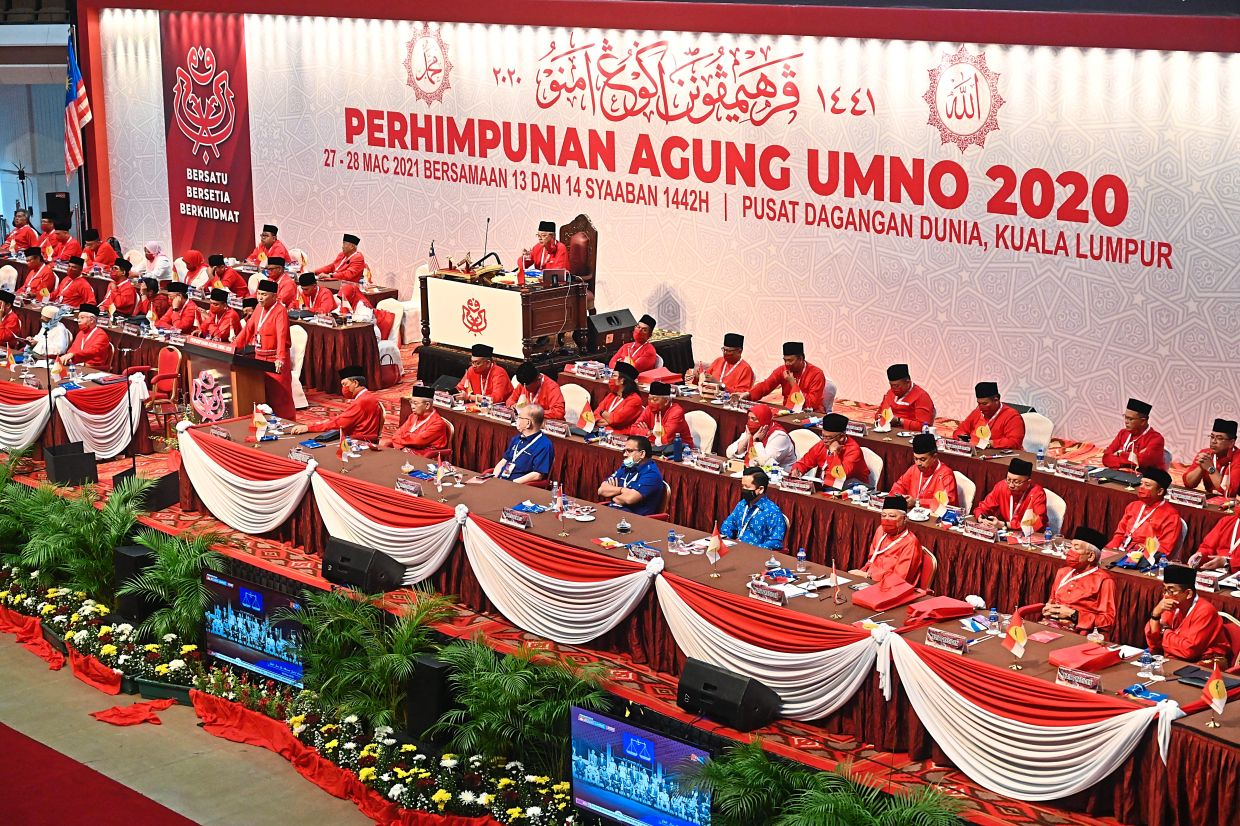 Full attention: Umno supreme council members and Barisan leaders comprising (from third left) Dr Wee, Vigneswaran and Arthur listening to Ahmad Zahid delivering his presidential address at the Umno general assembly. — Pic courtesy of Umno Media