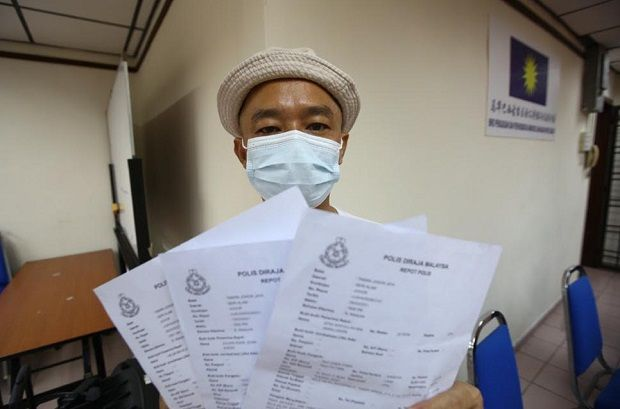 Tailor Teo Chen Chiek, 46, showing the three police report lodged regarding the incidents.