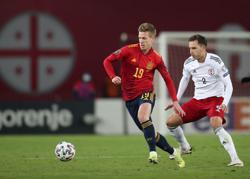 Soccer: Spain scrape win over Georgia with late Olmo strike