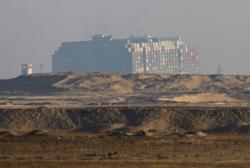 Oil slumps as Suez Canal container ship starts to move