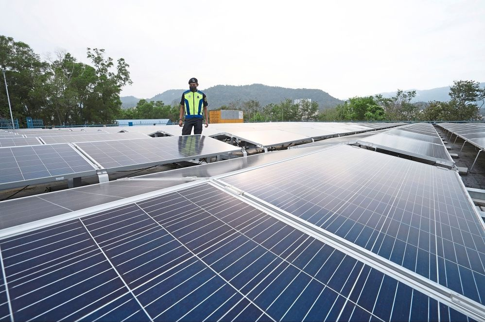 Solar panels installed on top of the enclosed  Bukit Dumbar reservoir in Penang.