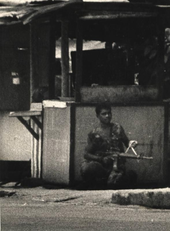 On a rampage: Prebet Adam taking a breather at a burger stall outside Wisma Sabaruddin at about 1.30pm on Oct 19, 1987, some two hours before he surrendered. This iconic shot by The Star photographer Abdullah Subir is the first photo taken of Adam during his rampage. Scanned Pix : Staric Date : 19.10.1987 Prebat Adam Jaafar caught taking a breather under a burger stall outside Wisma Sabaruddin at about 1.30pm.