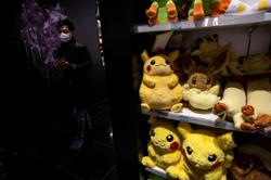 Man in Japan scales six-storey building to steal in-demand Pokemon trading cards