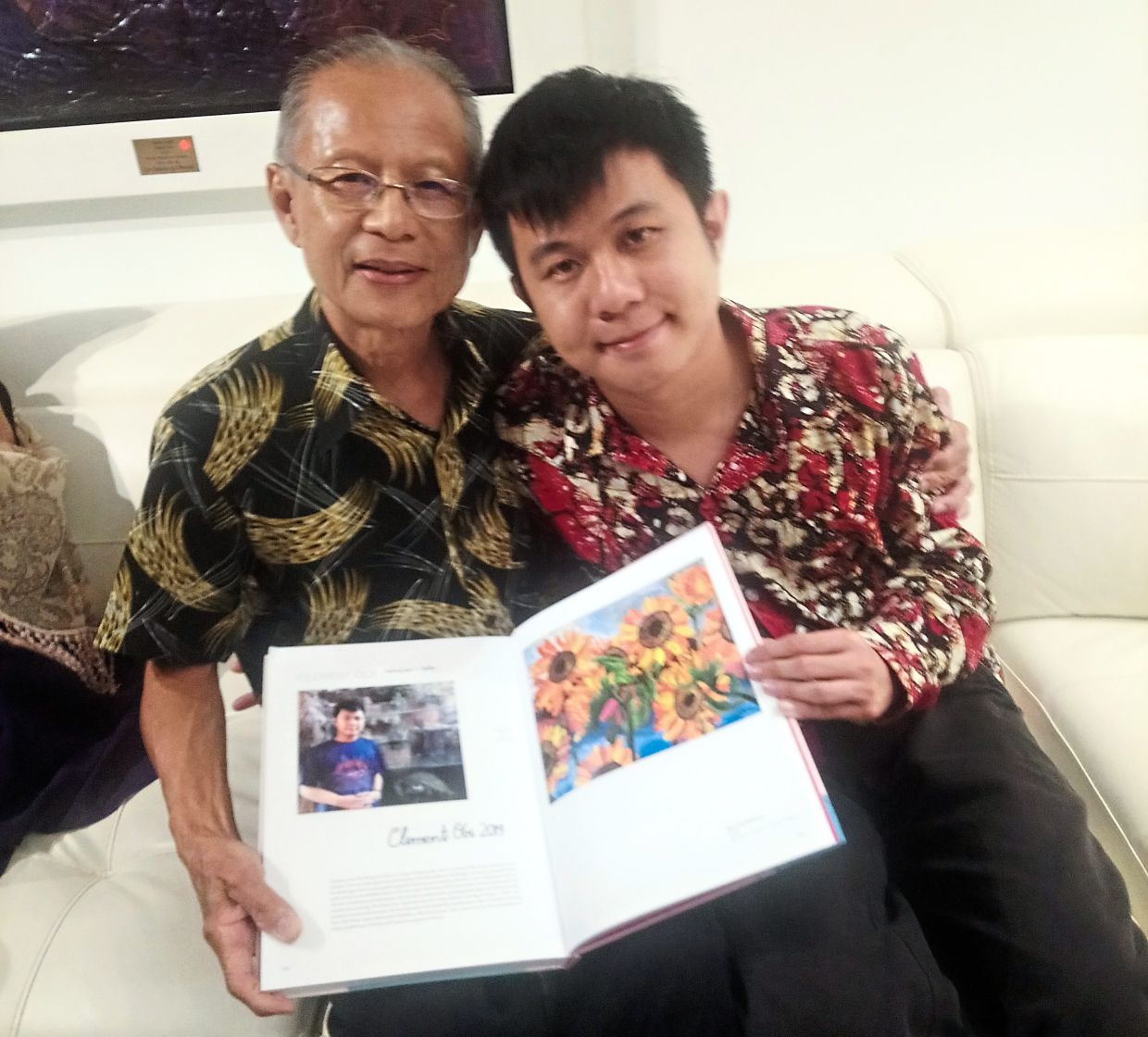 Clement (right) and his father Ooi Bee Lam. Photo: Ooi Bee Lam
