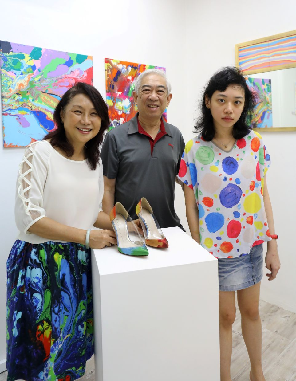 Janet Lee (right), pictured with her parents at the gallery. Photo: The Star/Samuel Ong