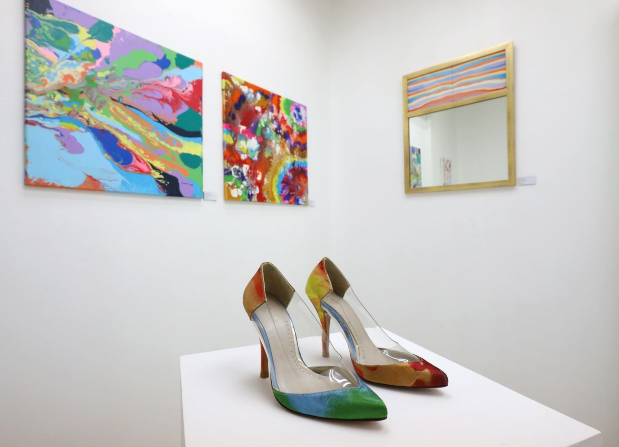 Janet Lee's art is also featured beyond the canvas on merchandise such as shoes, bags, postcards and others. Photo: The Star/Samuel Ong