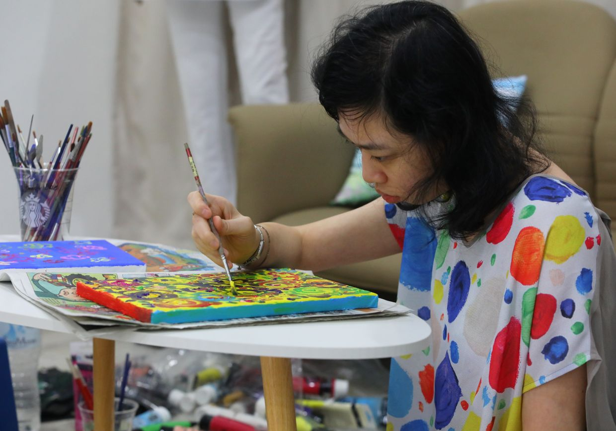 While most artists have an object in mind when painting, Janet Lee's object is colour. Photo: The Star/Samuel Ong