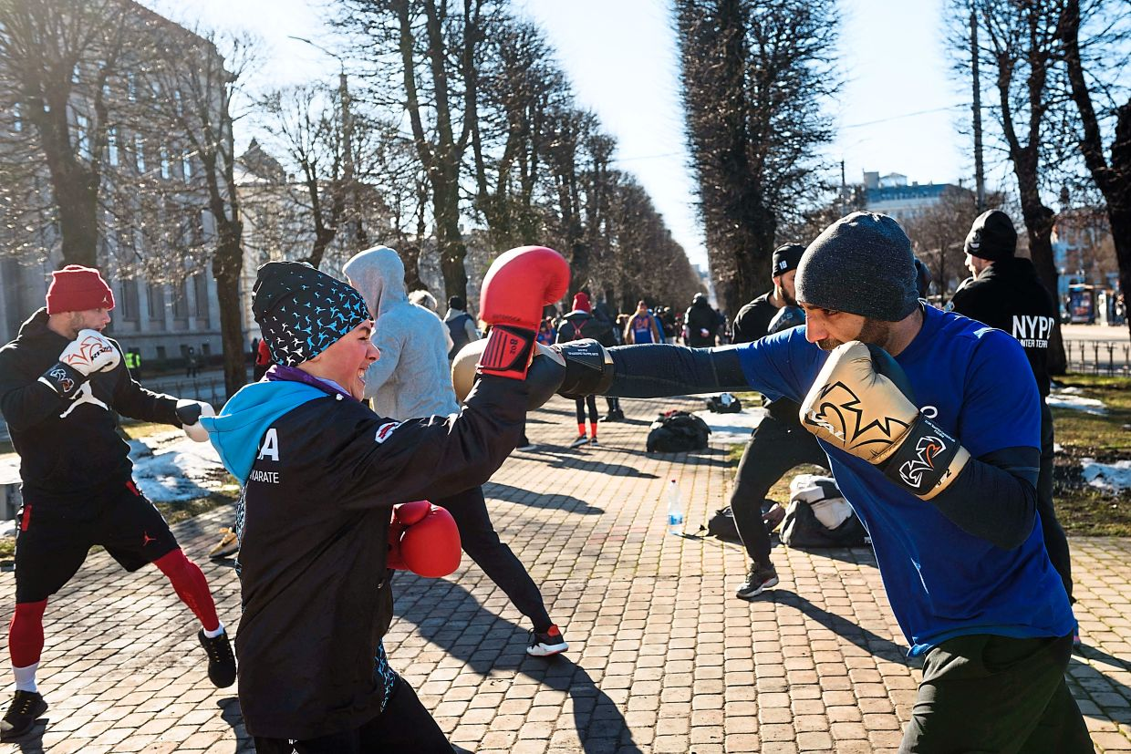 When it comes to group fitness classes, kickboxing classes might be more up the male alley. — AFP