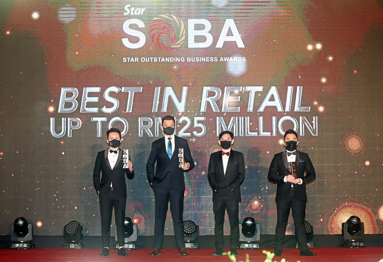 More Design Group Sdn Bhd won the Platinum prize for Best in Retail in the up to RM25mil category. Its CEO Frank Wong (second from left) is happy to take home the trophy as a first-time participant in SOBA. He is seen here with (from left) Ezzybucks Sdn Bhd CEO, Yeow and Illegear Sdn Bhd managing director Chin Jiun How.