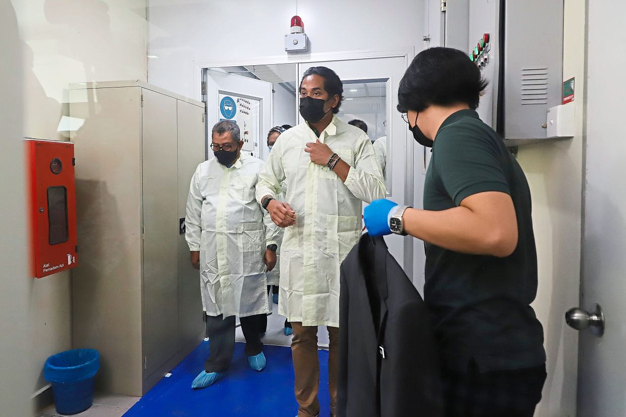 All geared up: Khairy putting on a PPE while visiting the Catalyst for Malaysia's Technology Ecosystem in Bukit Jambul, Penang.