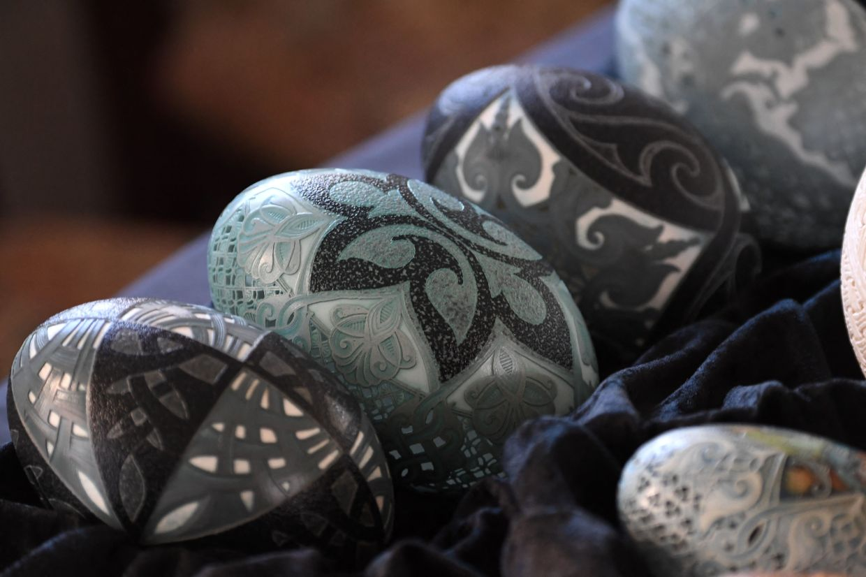 Through the years, Csuhaj developed her own style, etching and carving eggshells with a hand drill. Photo: AFP