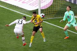 Soccer-Eintracht win at Dortmund to boost Champions League hopes