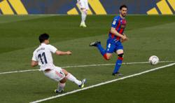 Soccer-Asensio and Benzema fire Real Madrid to victory over Eibar