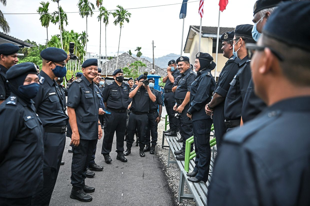 All smiles: Abdul Hamid (third from left) chatting with officers from the unit after the launch. — Bernama