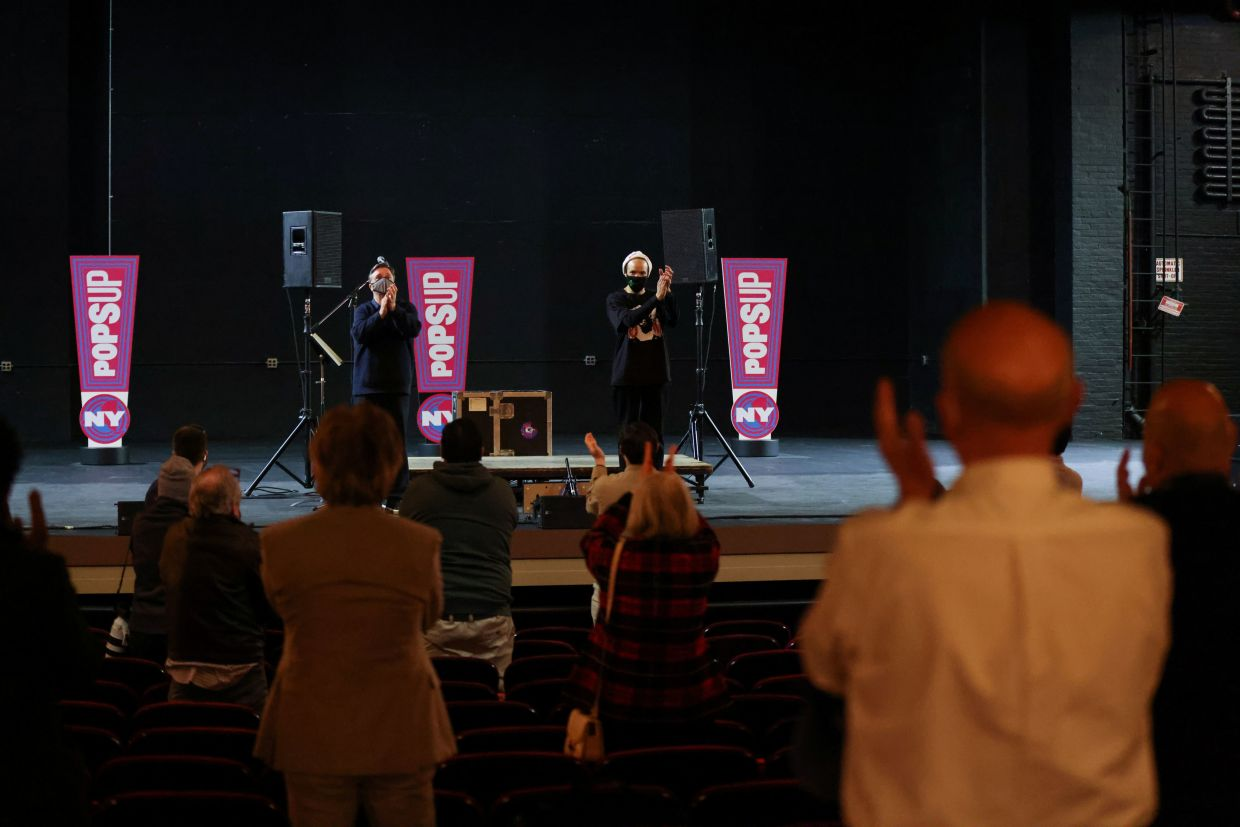 Audience members give a standing ovation after performances by Savion Glover and Nathan Lane. Photo: Reuters