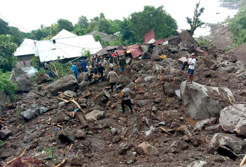 Rescuers search for victims at a village hit by a landslide in Ile Ape Timur on Lembata Island, East Nusa Tenggara province, Indonesia, Monday, April 5, 2021. Multiple disasters caused by torrential rains in eastern Indonesia and neighboring East Timor have left a number of people dead or missing as rescuers were hampered by damaged bridges and roads and a lack of heavy equipment Monday. - AP
