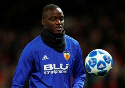Soccer-Valencia told to play on after walk-off over alleged racist insult-Gaya