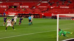 Soccer-Atletico's title bid falters again with loss at Sevilla