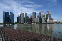 Facing pressure at home, Chinese tech giants expand in Singapore