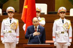 Nguyen Xuan Phuc, Vietnam's pandemic response leader sworn in as president