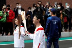 Osaka requests cancellation of torch relay leg