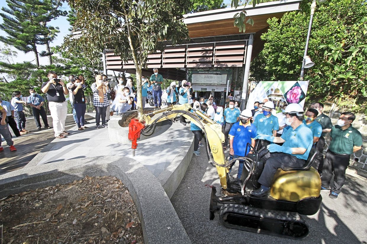 Chow (front, right) performing the groundbreaking ceremony on Penang Hill.
