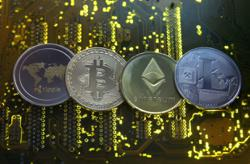 Singapore warns public against crypto as world warms to Bitcoin