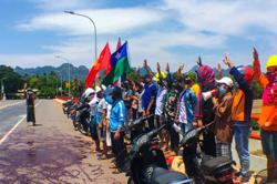 Myanmar activists continue fight against Army by splashing red paint to protest junta bloodshed
