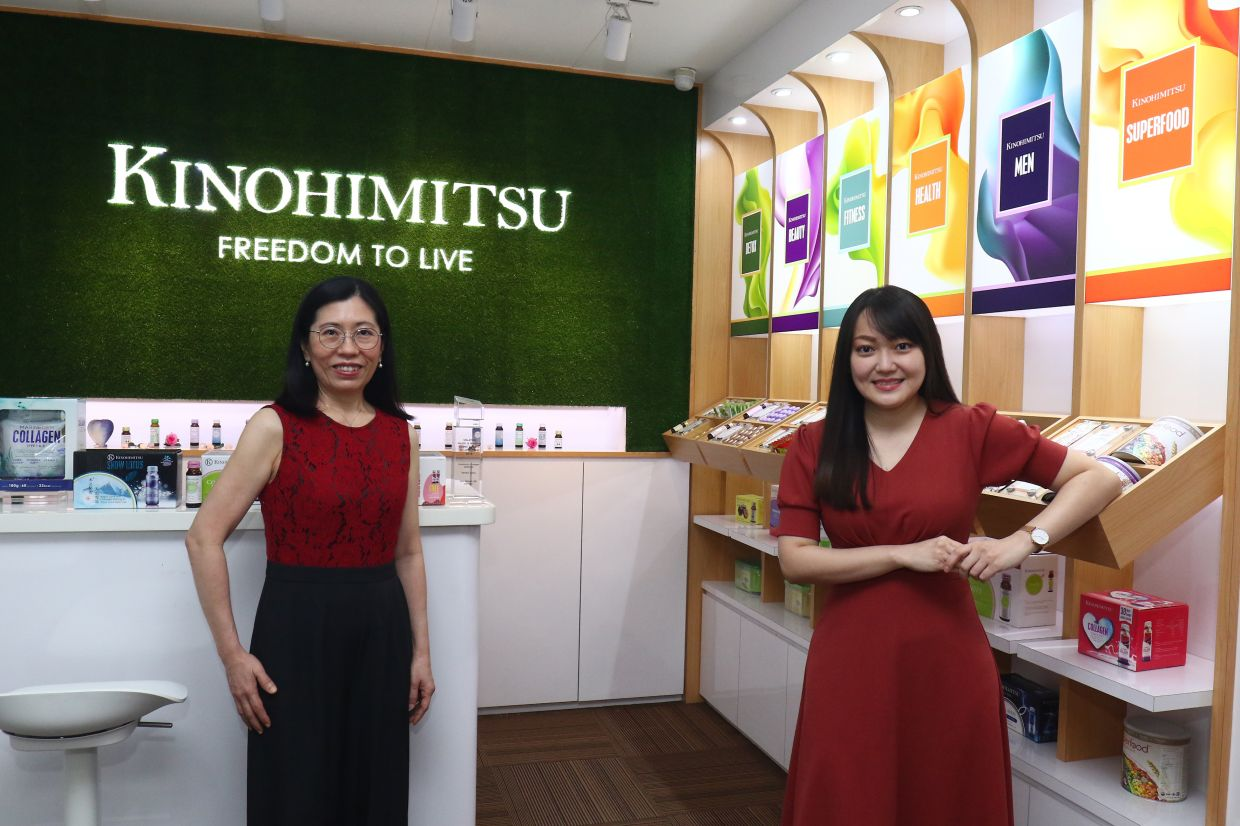 Chin (left), Kino Biotech (M) Sdn Bhd chief operating officer and Gan, Kino Biotech (M) Sdn Bhd marketing executive and nutritionist, are true believers in collagen products. — FAIHAN GHANI/The Star