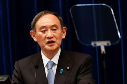 Japan PM Suga signals chance of calling snap election - Asahi