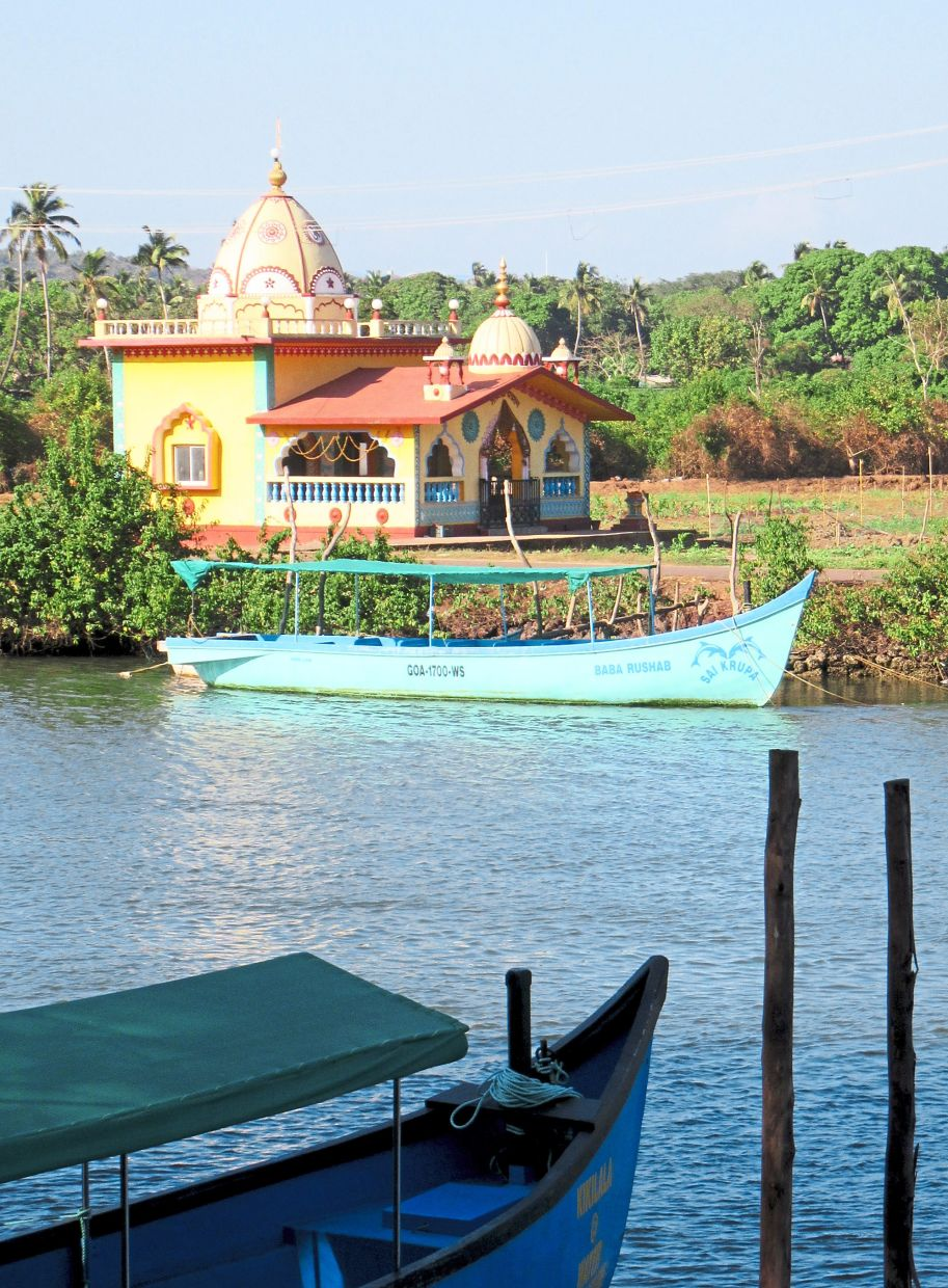 Spirituality is everywhere in Goa. On a boat tour through the small canals, you will spot plenty of colourful temples on the shore.