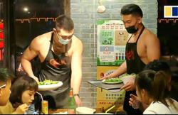 Shirtless waiters deliver good service at hotpot restaurant in China