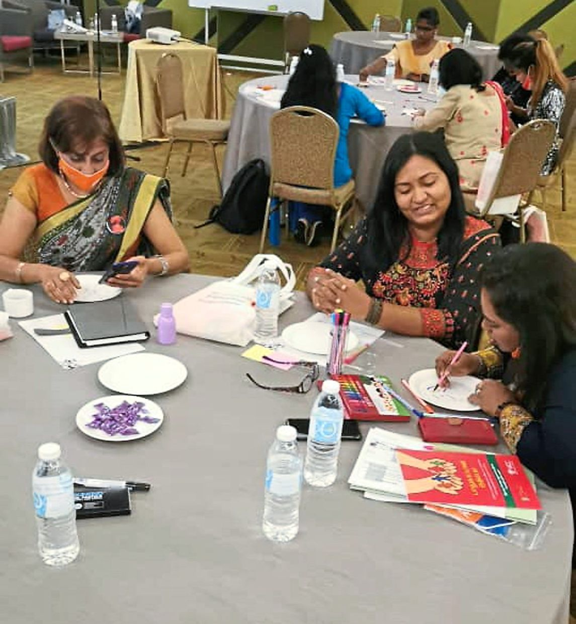 Workshop participants undergoing training to aid domestic violence victims.