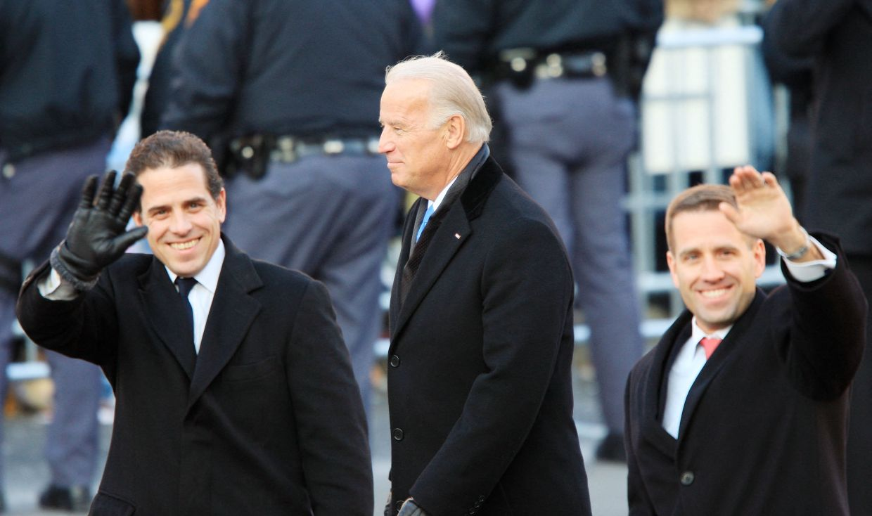 Soulmates: Hunter (left) with his brother and Beau and their father in the inaugural parade for President Obama in 2009. Hunter's life hit rock bottom after his brother's death.  — AFP
