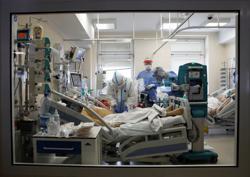 'This is war': Polish medics just taking naps between COVID shifts