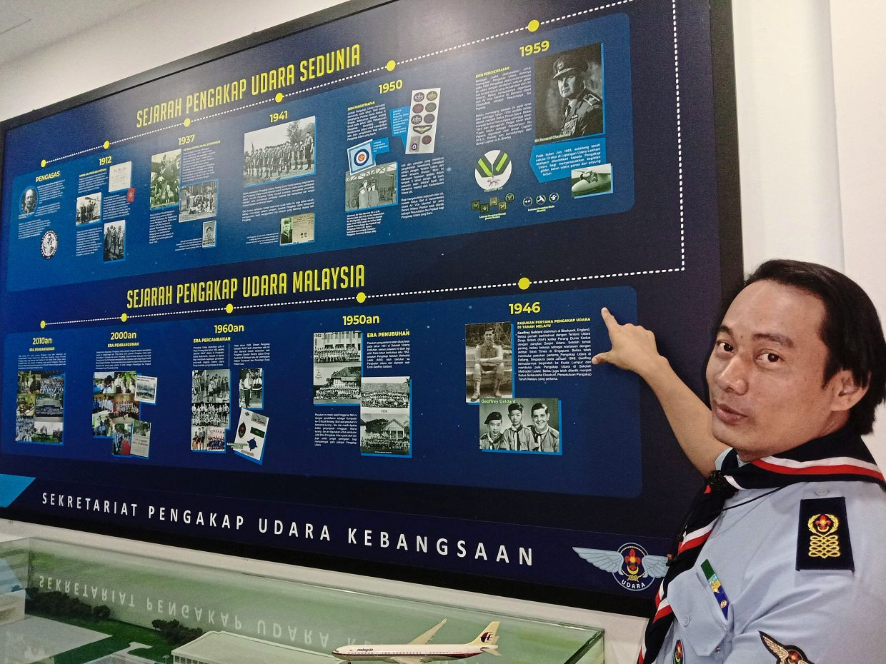 Abdul Mueiem showing the milestones of the Malaysian Air Scout movement at the museum within the Scouts Association headquarters in Kuala Lumpur.