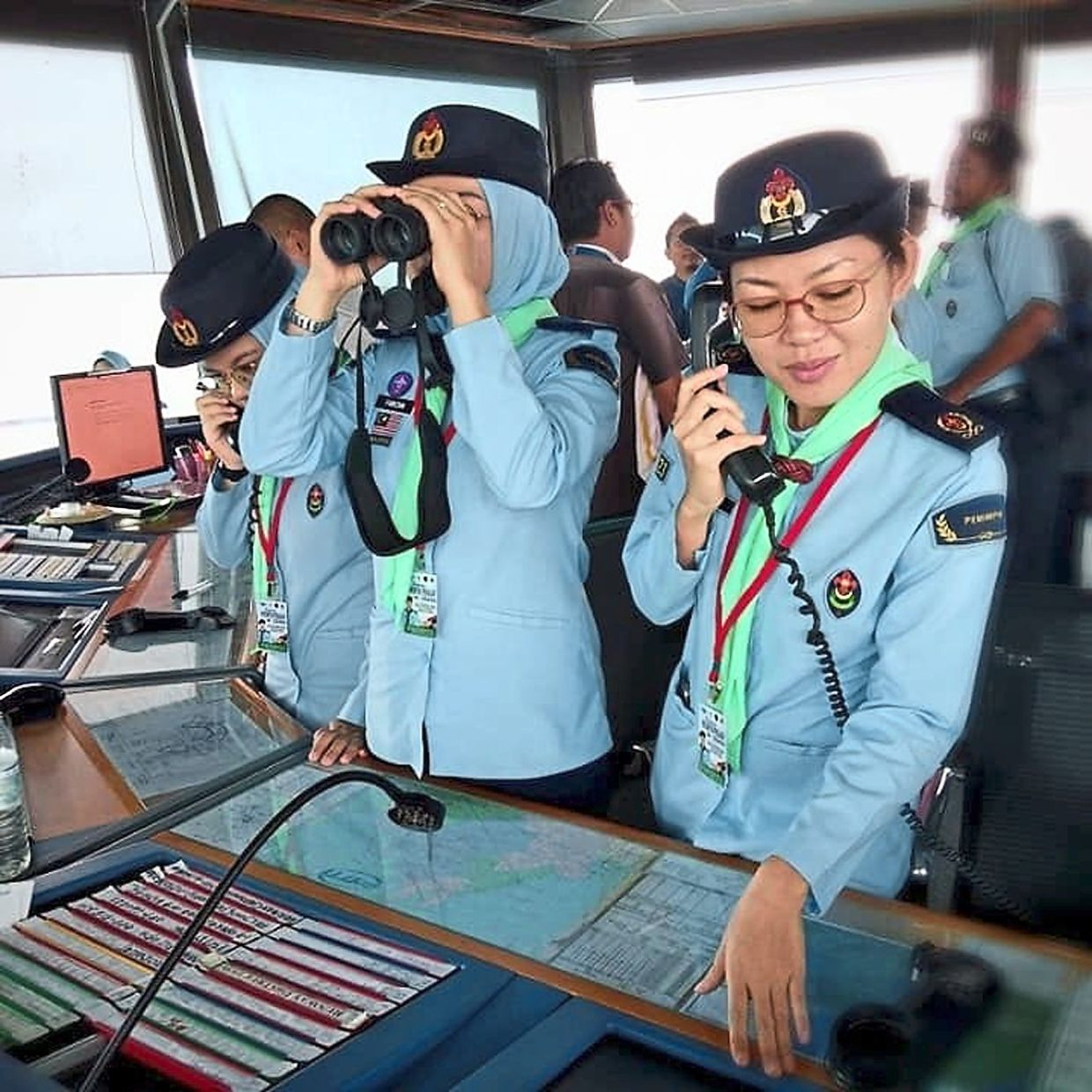 Air Scout leaders course participants, comprising mostly teachers, at the Sandakan Airport control tower in 2019. Part of the training included familiarisation with air traffic patterns.