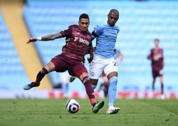 Soccer-Man City suffer 2-1 home defeat by 10-man Leeds