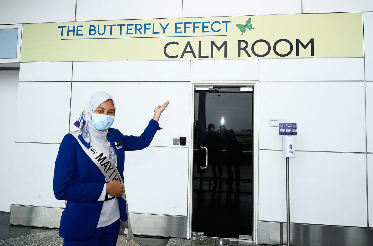 Caring: A KLIA customer service officer showing the Calm Room on Level 5.