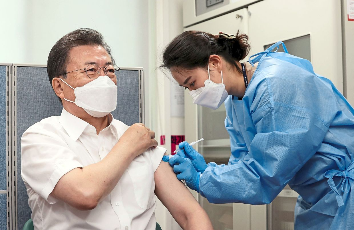 Moon receiving a dose of the AstraZeneca Covid-19 vaccine at a public health centre in Seoul in March. To date only 2% of the South Korean population has been vaccinated. — AFP