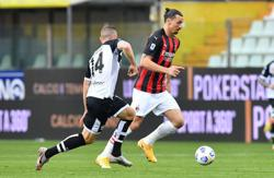 Soccer-Milan edge past Parma as Ibrahimovic sees red