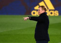Soccer-Koeman furious with referee after Barca beaten by Real