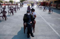 The day before elections, Peru marks record COVID-19 deaths