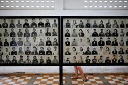 Cambodia condemns VICE for images by artist who added smiles to Khmer Rouge victims