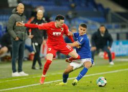 Soccer-Birthday boy Serdar scores as Schalke claim narrow win over Augsburg