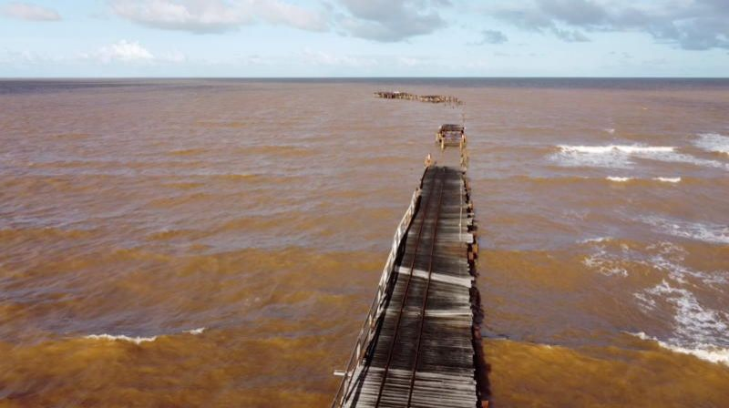 One Mile Jetty is seen destroyed by tropical cyclone Seroja in Carnarvon, Australia April 11, 2021, in this still image taken from drone video footage obtained from social media by Reuters.