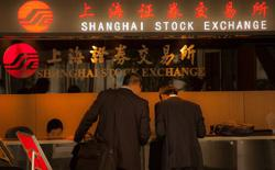 China stocks end lower as materials, transport firms weigh